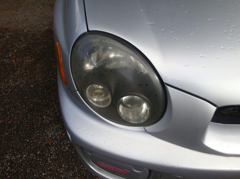 Subaru Impreza cloudy/yellow headlight Surrey - Before